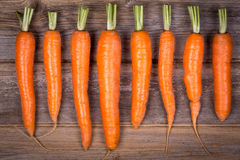 Trimmed carrots in a row Stock Photo