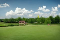 Trimmed field and sand bunkers on golf course Stock Photography