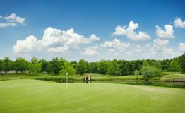 Trimmed field and sand bunkers on golf course Stock Images