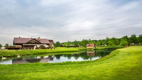 Trimmed field and sand bunkers on golf course Royalty Free Stock Photo