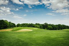 Lawn and sand bunkers for golfing on golf course Royalty Free Stock Photo
