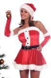 Trimmen des Weihnachtsbaums Stockfoto