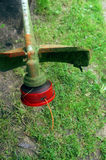 Trimmer. Garden Equipment Repair And Maintenance. Old trimmer on green grass Stock Photography
