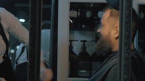 Trimming beard in barbershop stock video footage