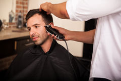 Trimming hair in a barber shop Royalty Free Stock Images
