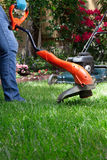 Trimming Lawn Stock Photography