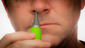 Trimming Nose Hair Stock Images