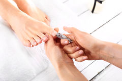 Trimming toenails, woman on pedicure Stock Photos