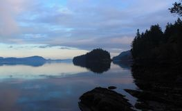 Island reflection in the Trincomali Channel, Salt Spring Island BC Stock Photo