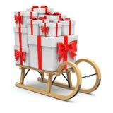 Trineo de madera con los regalos Foto de archivo