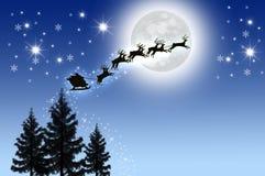 Trineo de Santa en cielo nocturno Foto de archivo