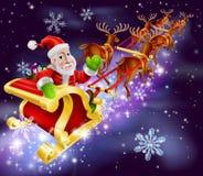 Trineo del vuelo de Santa Claus de la Navidad con los regalos Imagen de archivo libre de regalías