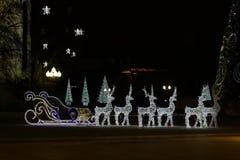 Trineo y renos eléctricos de Santa Claus imágenes de archivo libres de regalías