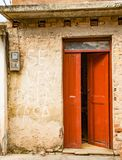 Open red door on yellow wall with power meter. Sign on walls say. Trinidaad, Cuba Nov 26, 2017 - Open red door on yellow wall with power meter. Sign on walls Royalty Free Stock Images
