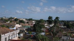 Trinidad City Establishing. A panning establishing shoot in Cuba. The shoot starts from a church in Trinidad City and ends at the Playa Ancon Beach by the ocean stock video footage