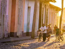 Trinidad, CUBA - Caribbean street at sunset. Trinidad, Cuba on December 29, 2015: The warm sunset light shines on the streets of the city centre in the Cuban Stock Photos