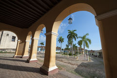 Trinidad Cuba Colonial Architecture Plaza Mayor. View of the Plaza Mayor between archways in the portico of the historic colonial architecture of the Palacio stock photography