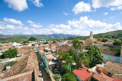 Trinidad Cuba Colonial Architecture Terra Cotta Skyline. White clouds float in blue sky above the terra cotta rooftops of the historic colonial architecture in Royalty Free Stock Photography