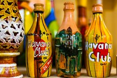 Trinidad, Cuba - 2019.Decorative bottles on a shelf in Trinidad, Cuba. Hand made bottle designs.  royalty free stock photos