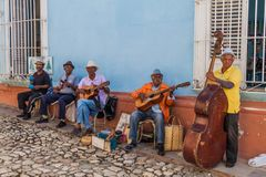 TRINIDAD, CUBA - FEB 8, 2016: Group of local musicians plays on a street in the center of Trinidad, Cub. A stock images