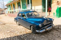 American classic cars parked in Trinidad city. UNESCO World Heri Stock Image