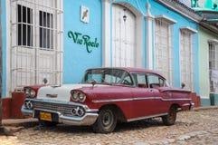 Trinidad, CUBA - JANUARY 28, 2013: Old classic American car park Royalty Free Stock Photos