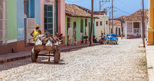 TRINIDAD, CUBA - MARCH 30, 2012: Horse carriage and vintage car Royalty Free Stock Images