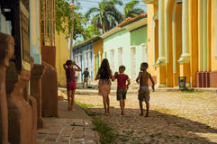 TRINIDAD, CUBA - MAY 26, 2013 Cuban local kids walking on the st Royalty Free Stock Photo