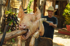TRINIDAD, CUBA - MAY 26, 2013 Cuban local man roasting pork on o Royalty Free Stock Image