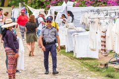 TRINIDAD, CUBA - MAY 16, 2017: A policeman at the local souvenir market. Copy space for text. royalty free stock photo