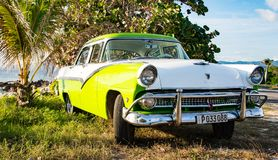Green and white Ford Fairlane parked on beach. Trinidad, Cuba, Nov 28, 2017 - Green and white 1950`s Class America Ford Fairlane parked on beach stock photography