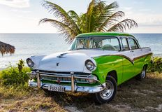 Green and white Ford Fairlane parked on beach. Trinidad, Cuba, Nov 28, 2017 - Green and white 1950`s Class America Ford Fairlane parked on beach royalty free stock images