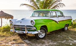 Green and white Ford Fairlane parked on beach. Trinidad, Cuba, Nov 28, 2017 - Green and white 1950`s Class America Ford Fairlane parked on beach royalty free stock photos