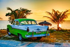 Green and white Ford Fairlane parked on beach. Trinidad, Cuba, Nov 28, 2017 - Green and white 1950`s Class America Ford Fairlane parked on beach royalty free stock image
