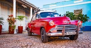 Red Classic Chevy is parked in front of a home. Trinidad, Cuba, Nov 28, 2017 - Red Classic 1950`s Chevrolet is parked in front of a home royalty free stock photo