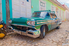 TRINIDAD, CUBA - SEPTEMBER 8, 2015: Old American car. TRINIDAD, CUBA - SEPTEMBER 8, 2015: Classic Old American cars used for transportation and tourism services Royalty Free Stock Images