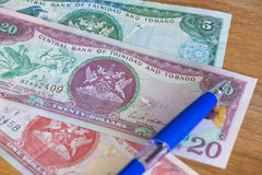 Trinidad and Tobago dollars with pen for calculations. Budget concept Royalty Free Stock Image