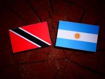 Trinidad and Tobago flag with Argentinian flag on a tree stump i Stock Photos