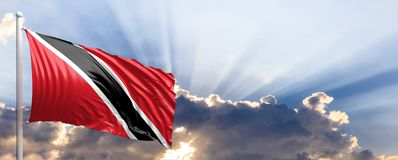 Trinidad and Tobago flag on blue sky. 3d illustration. Trinidad and Tobago waving flag on blue sky. 3d illustration Stock Photography