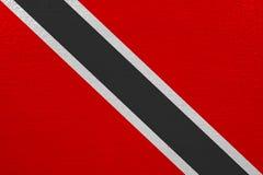 Trinidad and Tobago flag on canvas. Patriotic background. National flag of Trinidad and Tobago stock illustration