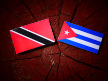 Trinidad and Tobago flag with Cuban flag on a tree stump isolate Royalty Free Stock Photos
