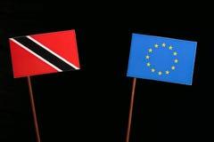 Trinidad and Tobago flag with European Union EU flag  on black Stock Image