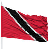 Trinidad and Tobago Flag on Flagpole. Flying in the Wind, Isolated on White Background Stock Photography