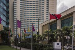 The Trinidad and Tobago flag flies proudly outside of the Parliament Building in Port-of-Spain, Trinidad Royalty Free Stock Images