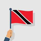 Trinidad and Tobago flag holding in hand man Royalty Free Stock Image