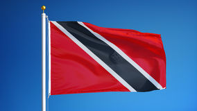 Trinidad and Tobago flag in slow motion seamlessly looped with alpha. Trinidad and Tobago flag waving in slow motion against clean blue sky, seamlessly looped stock footage