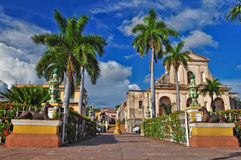 Trinidad de Cuba. Trinidad is a town in Cuba. 500-year-old city with Spanish colonial architecture is UNESCO World Heritage site. Trinidad is famous for its