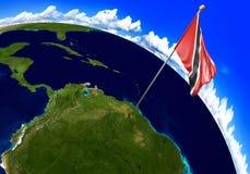 Trinidad und Tobago-Staatsflagge, die den Landstandort auf Weltkarte markiert Lizenzfreie Stockfotografie