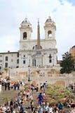 Trinità dei Monti. With Obelisco Sallustiano above Scalinata di  - Spanish Stairs with tourists in Rome, Italy stock photo