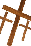 Trinity. Three wooden crosses showing the sign of the trinity in various religions Stock Image